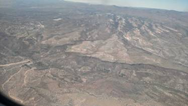 This is an aerial photo of Buckman showing some of the smoke from when the BLM fire crew burned the huge piles of branches on the northern end of the project area.
