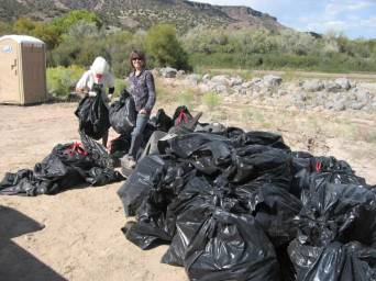 Here Norma McCallan from the Sierra Club and Sarah Sisk from Rio Grande Return are shown amongst a pile of garbage that was collected in just a portion the riparian area south of the diversion.
