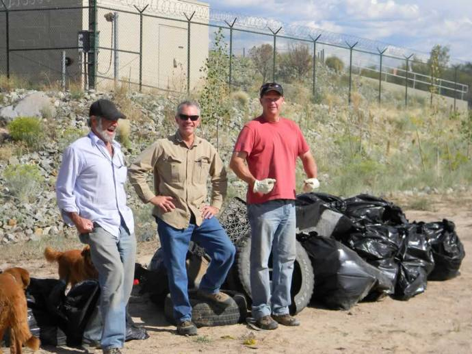 9. A volunteer, Steve Cary of Audubon NM, and Alan Hamilton Executive Director of Rio Grande Return just outside the Buckman Diversion with another pile of garbage collected by the volunteers.